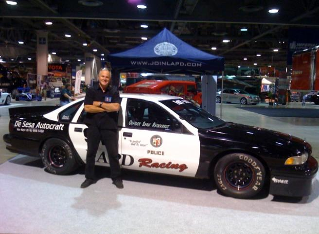 Officer Sean Reinhardt with the LAPD Racing Caprice at the Long Beach Grand Prix